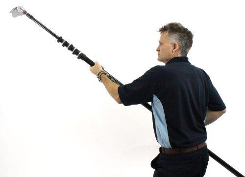 Man holding telescopic pole